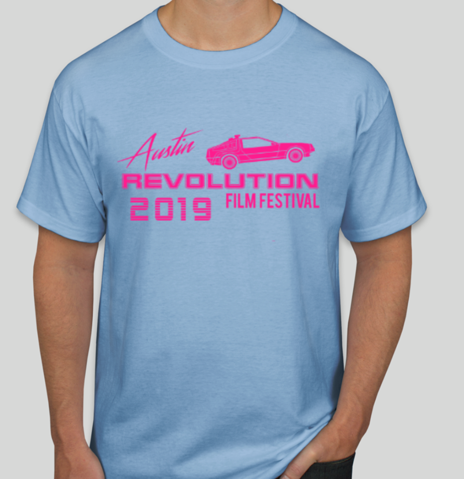 light blue t-shirt with bright pink image of car and text that says, Austin Revolution Film Festival 2019