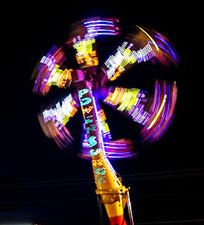 Night view of running carnival ride all lit up and running