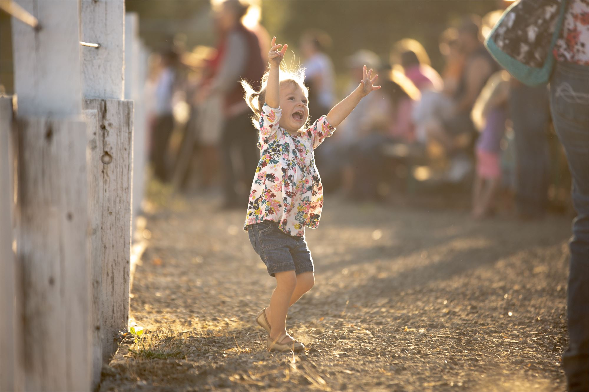 Happy child dancing on the lawn