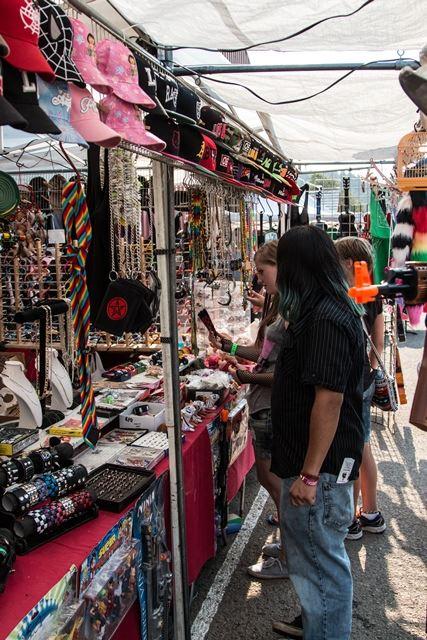 Woman examining wares at the Fair