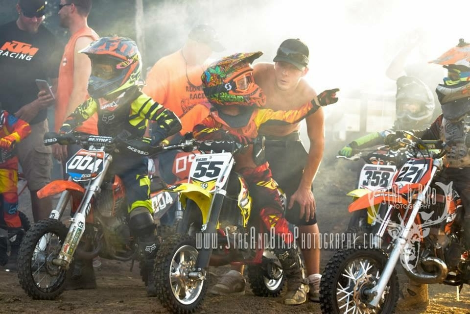 Molten Wohlburg and dad, Ryan, of Raymore, MO await the start of the 50cc racing l.