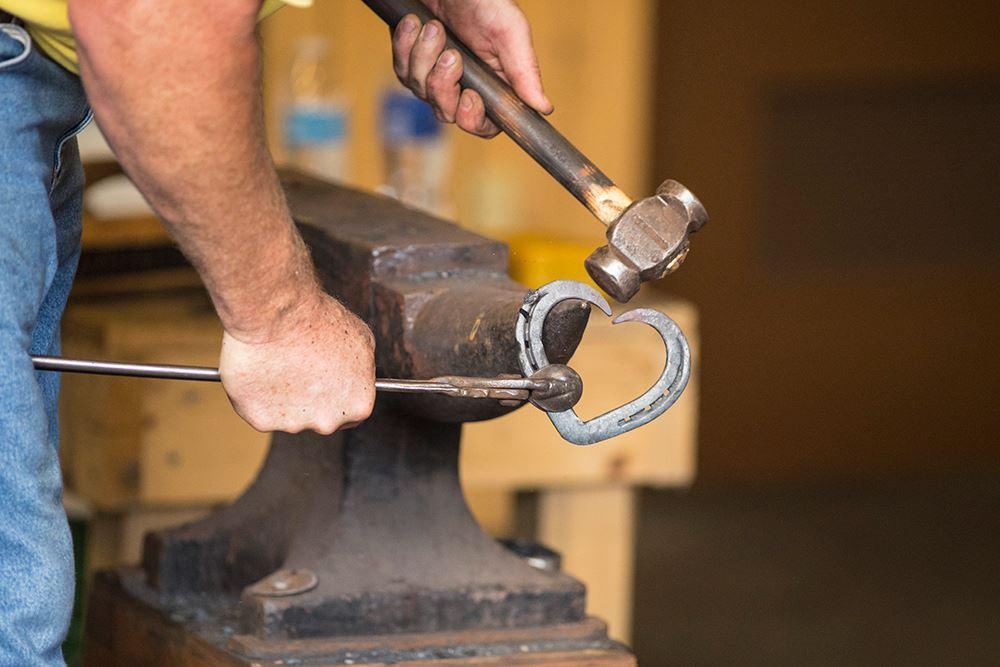 Blacksmith creating horseshoe