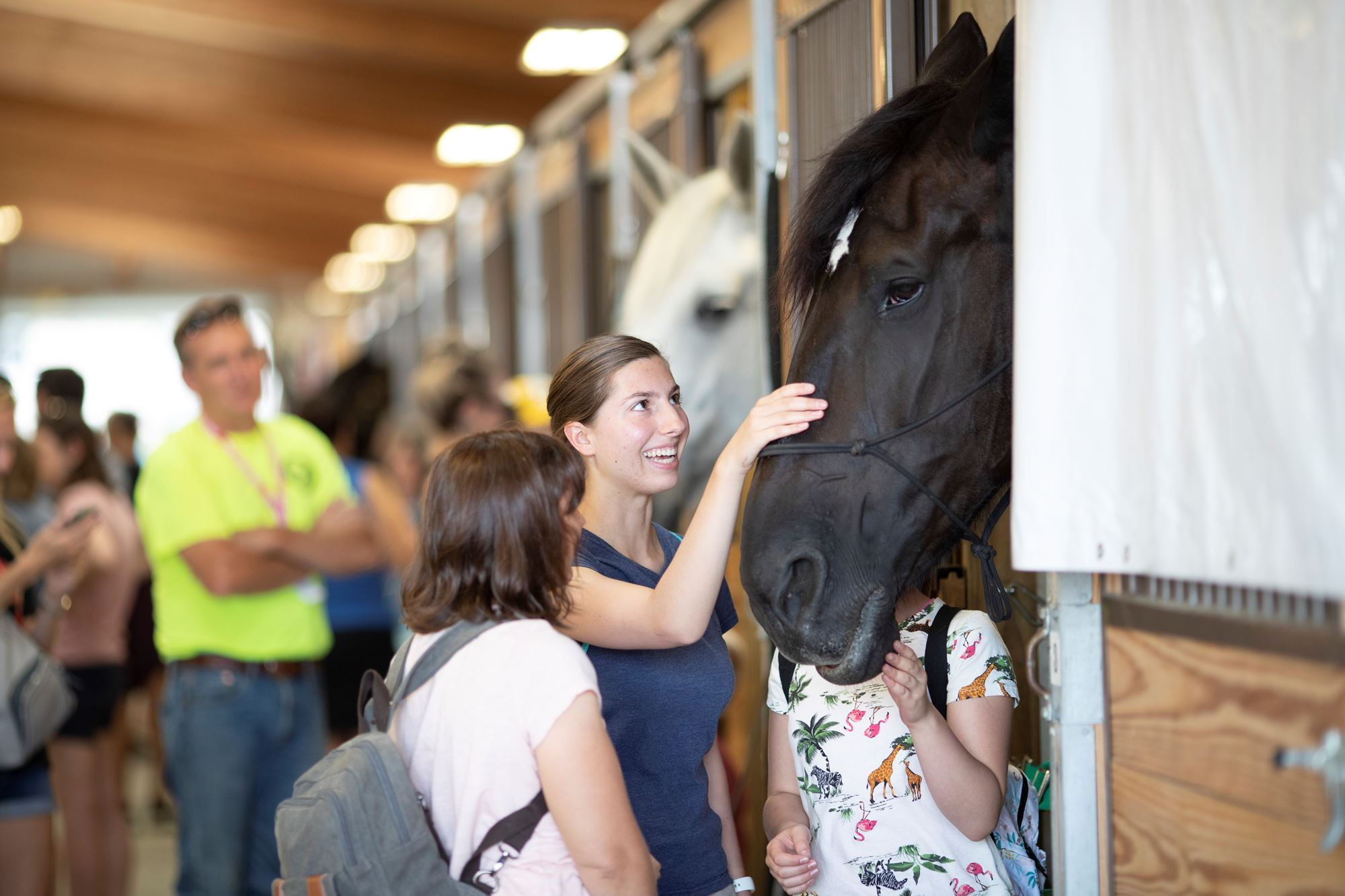 Fairgoers interacting inside Horse Headquarters