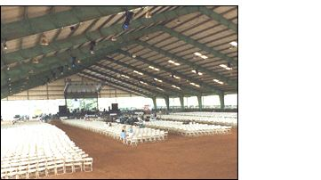 Large arena with chairs set up for concert
