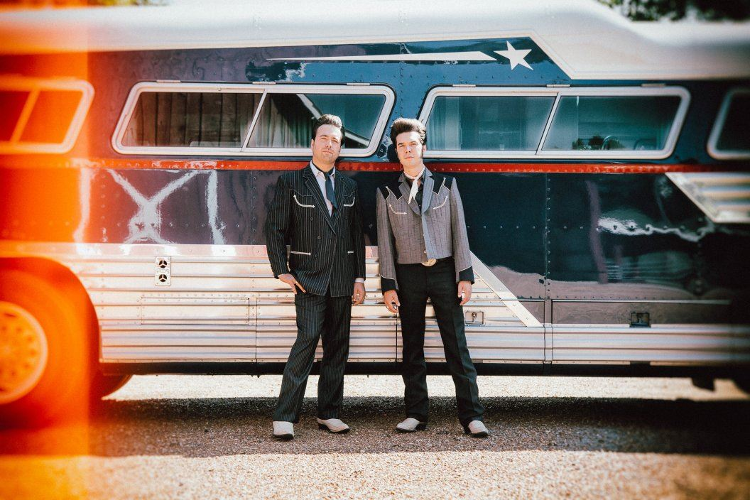 Malpass brothers with tour bus