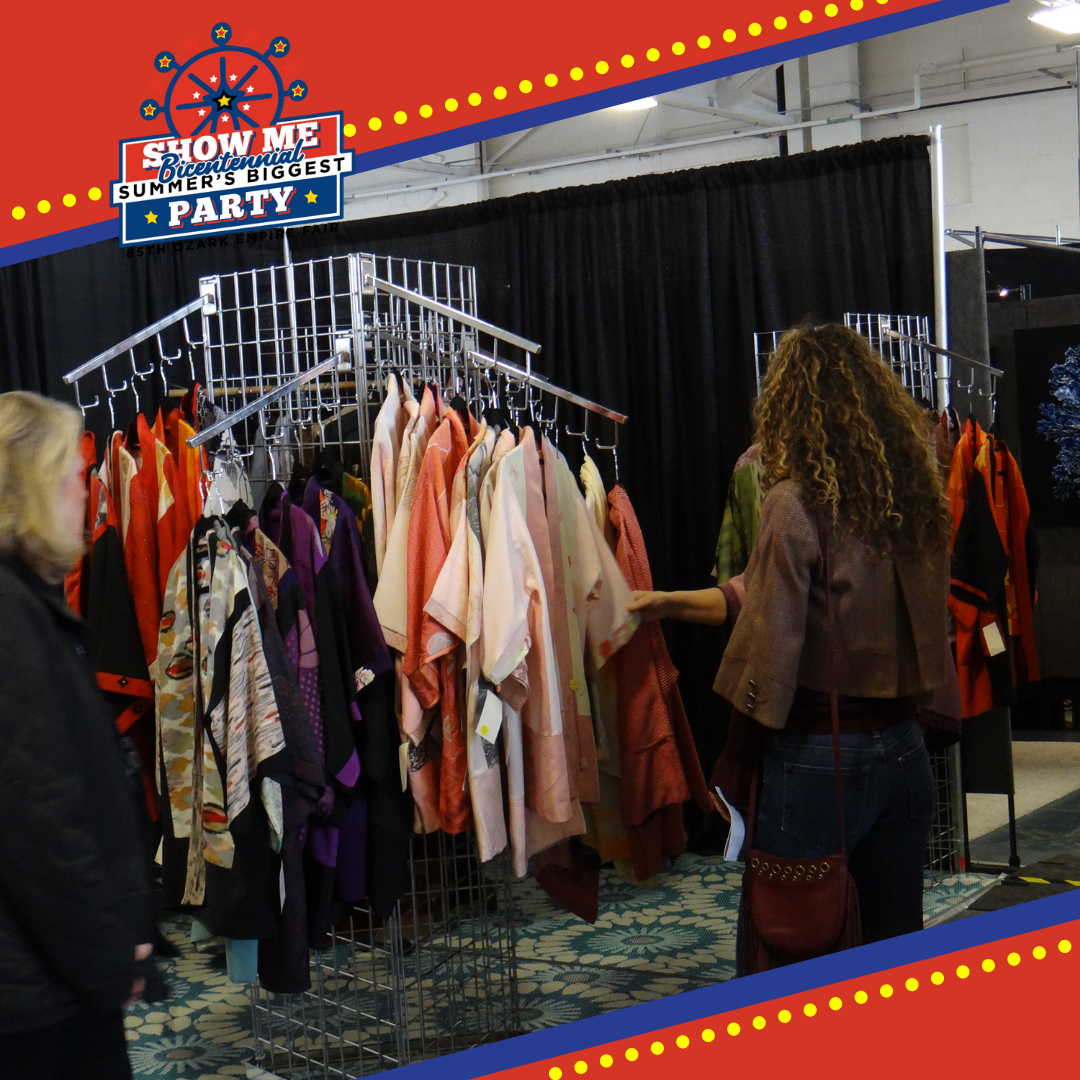 Inside the Eplex with vendors booths set up and people shopping