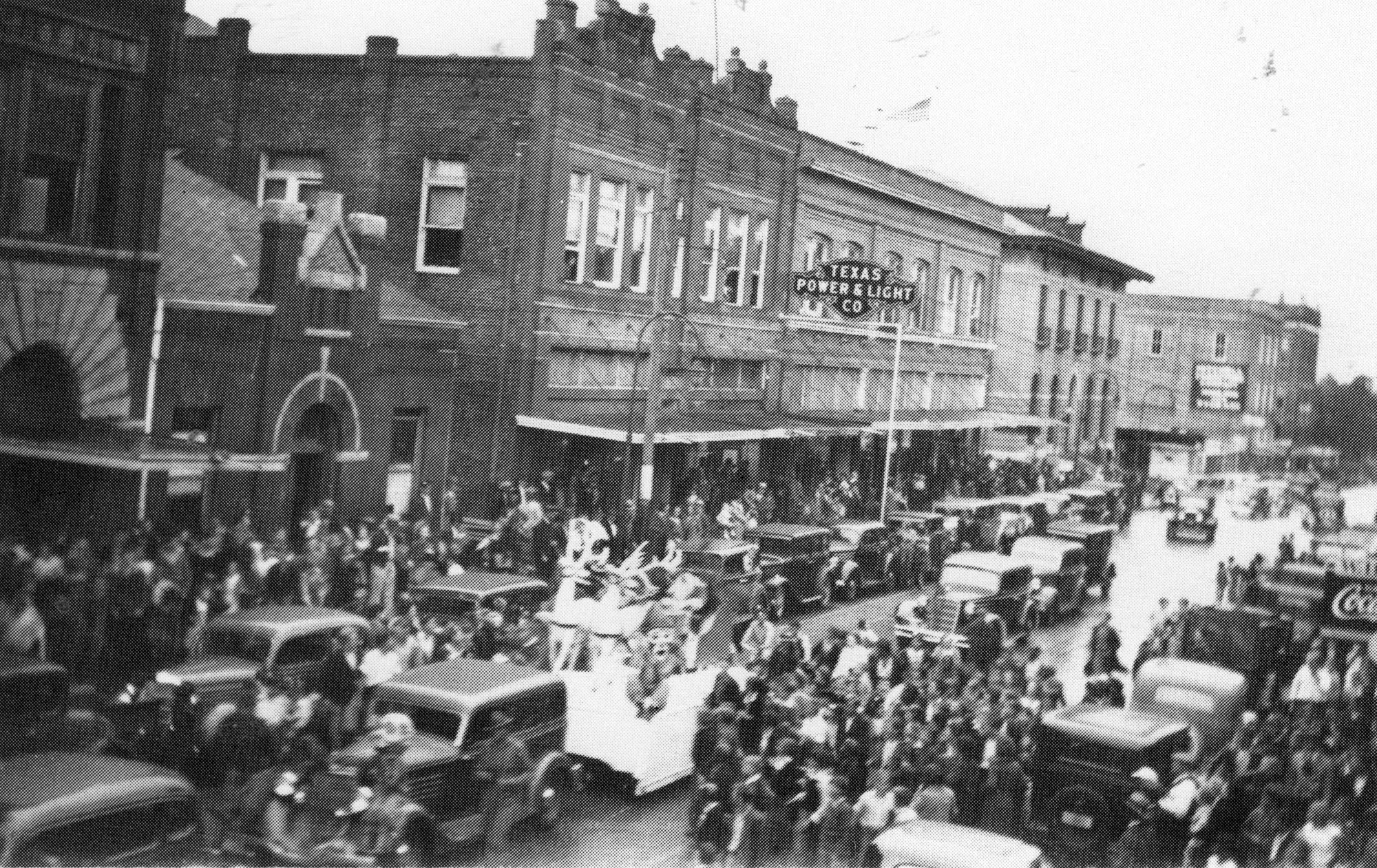 Parade in Front of Gardner Twin Building