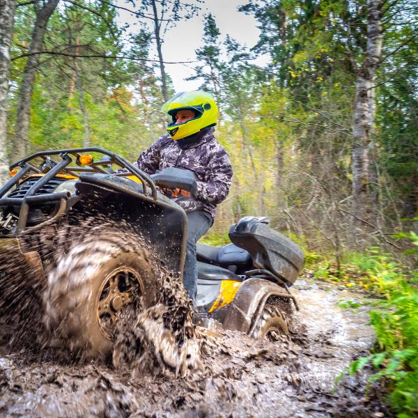 Rider mudding in ATV