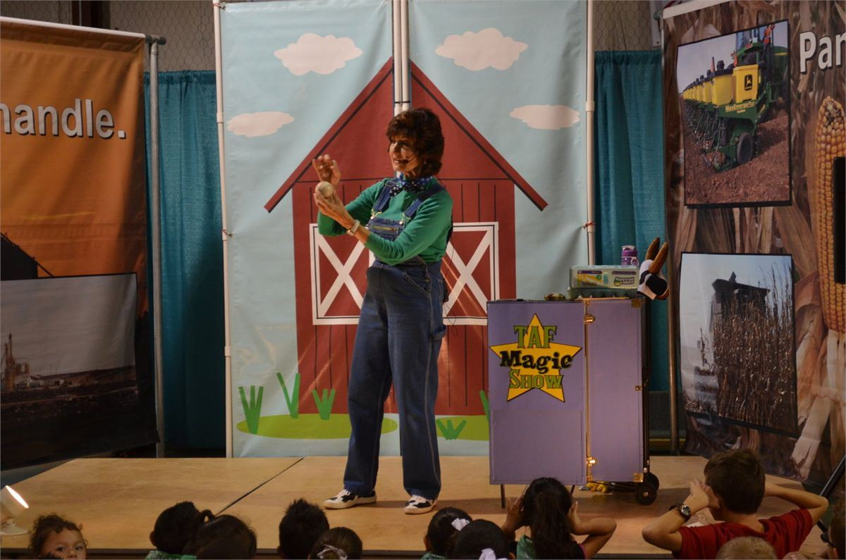 green shirt, overalls, red barn, black haired lady, kids, magic