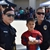 Boy as spider man and two female police officers at Cops N' Goblins in Buena Park, CA