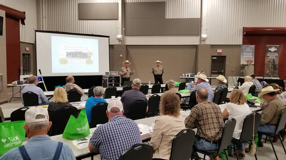 Agri-life cattle seminar, with attendees sitting in front of a productor
