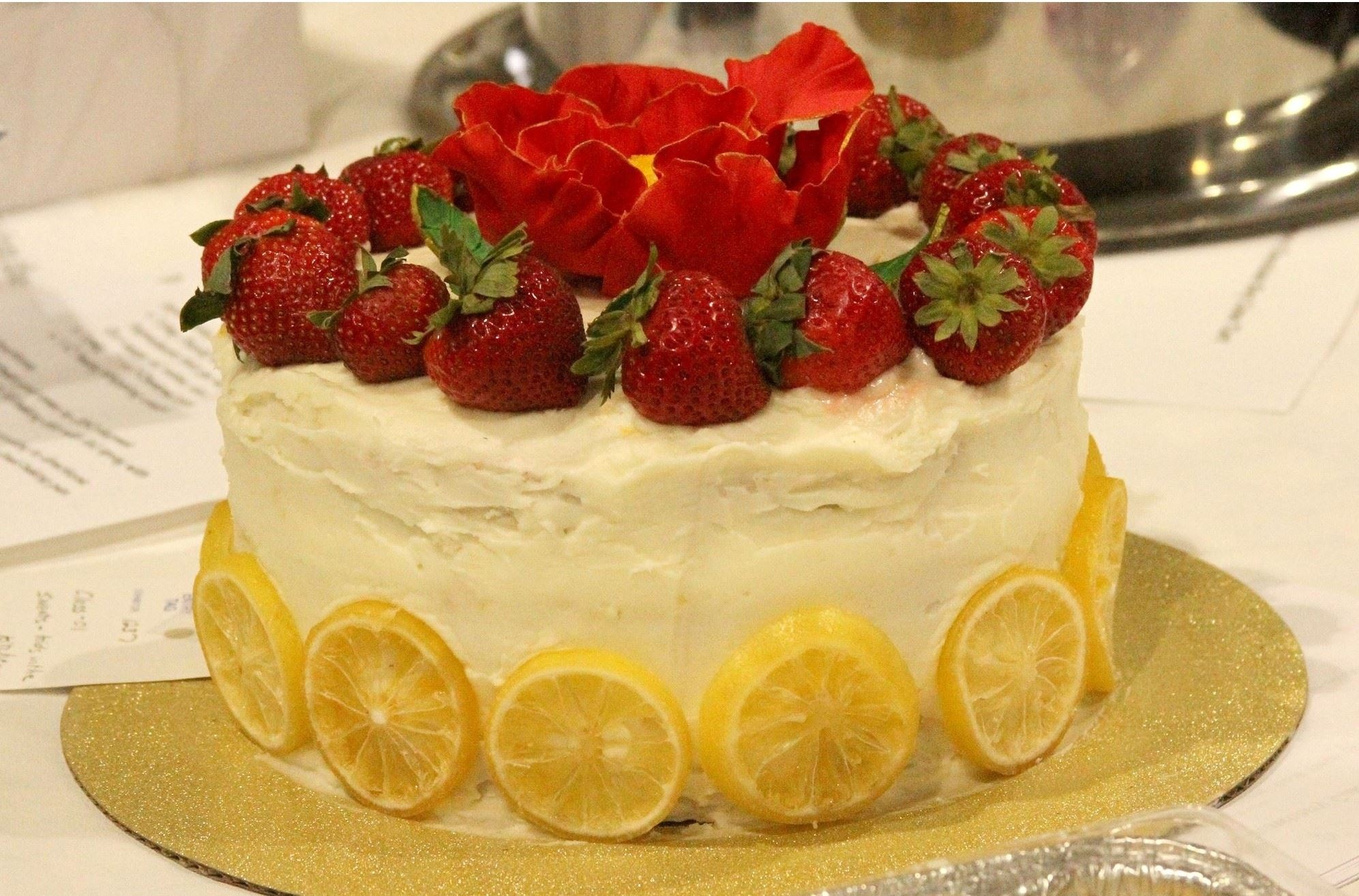 Cake with strawberries on top with link to enter Culinary Arts divisions.
