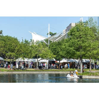 The Woodlands Waterway Arts Festival With Artist Booths by the Waterway Swan Boat and Pavilion in the Background