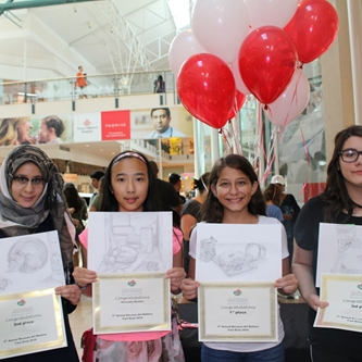 photo of four 7th & 8th grade students holding certificates
